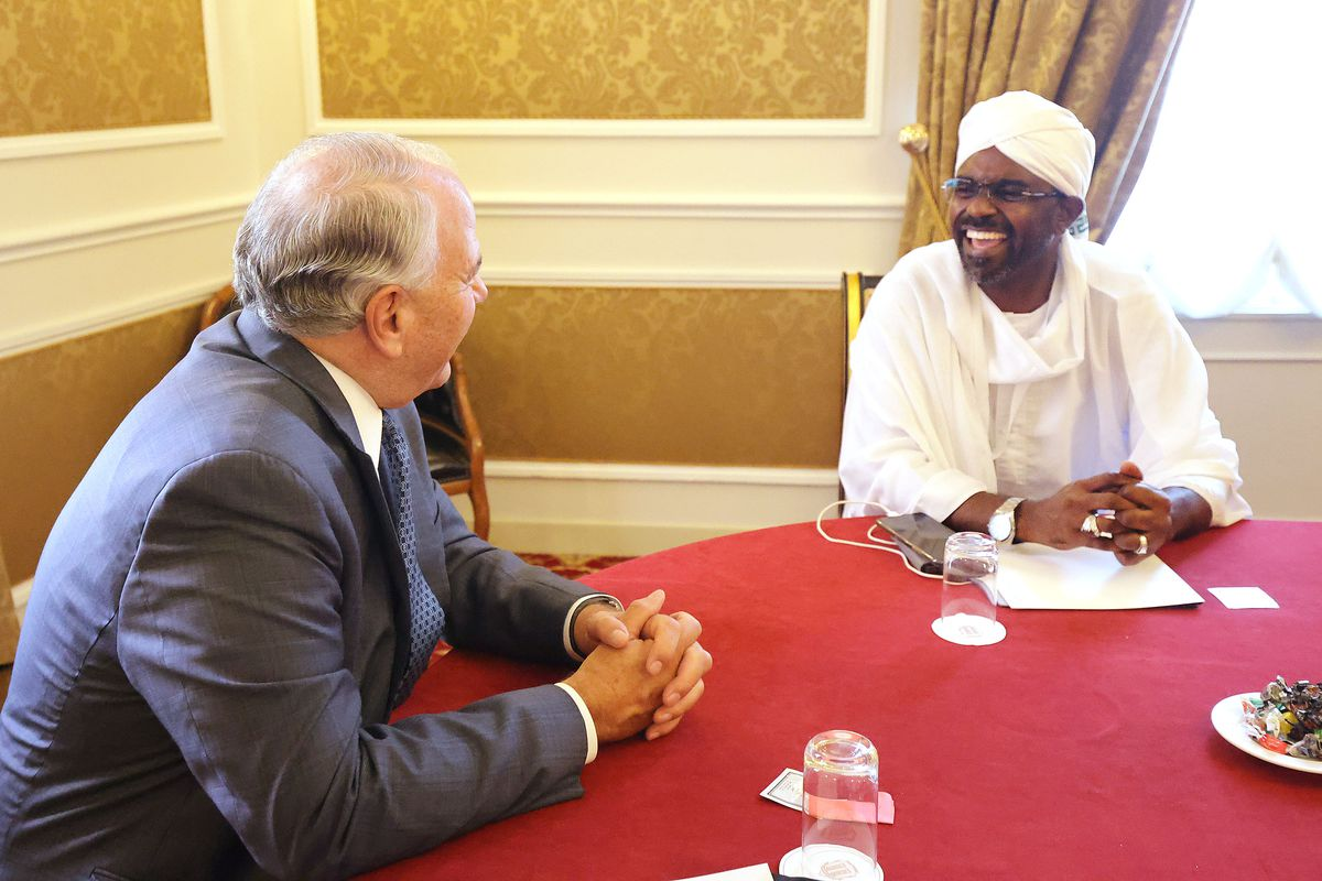 Elder Ronald A. Rasband, a member of the Quorum of the Twelve Apostles of The Church of Jesus Christ of Latter-day Saints, talks with Nasar-Eddin Mofarih, Sudan's minister of religious affairs.