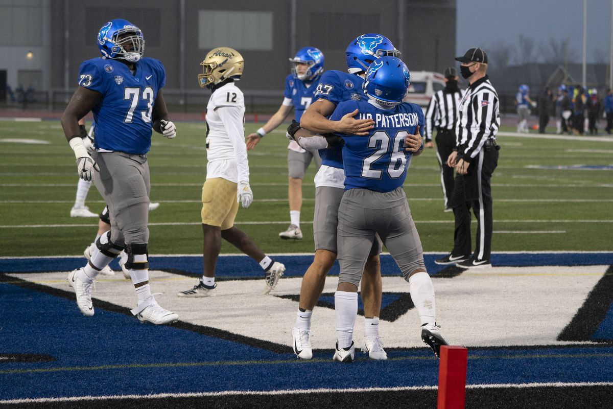 Buffalo Bulls Wide Receiver Jovany Ruiz congratulates Buffalo Bulls Running Back Jaret Patterson for scoring a touchdown during the first half of the College Football game between the Akron Zips and the Buffalo Bulls on December 12, 2020, at UB Stadium in Amherst, NY.