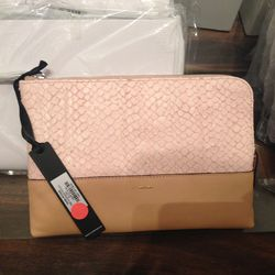 Oversize pouch in pink and tan, $49 (was $175)