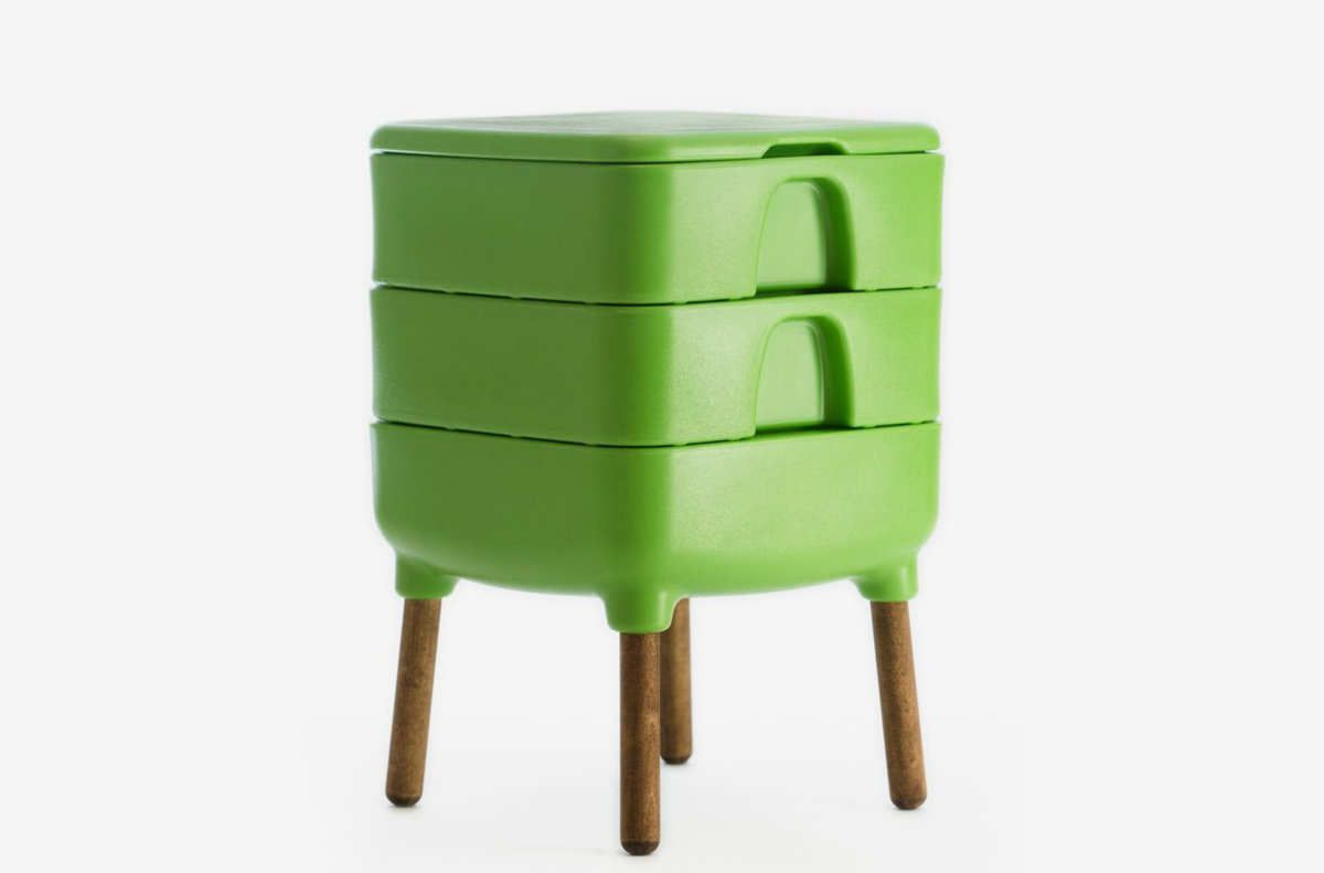 Bright green storage container with four wooden legs.