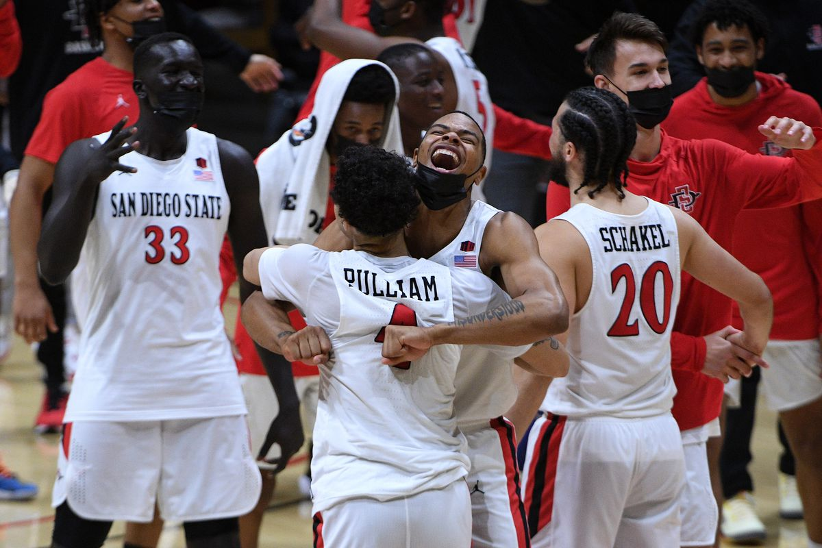 San Diego State Aztecs players celebrate on the court after defeating the Boise State Broncos at Viejas Arena.