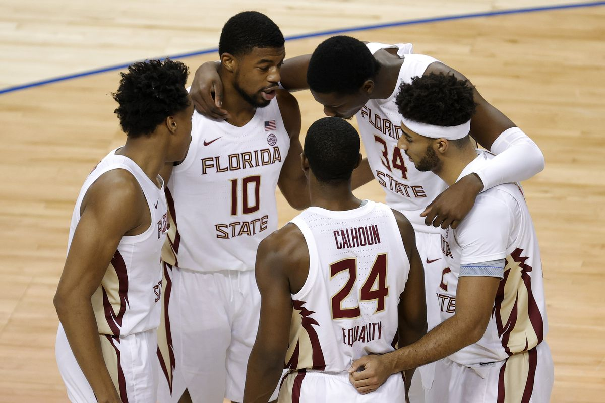 The Florida State Seminoles huddle during the second half of the ACC Men's Basketball Tournament championship game against the Georgia Tech Yellow Jackets at Greensboro Coliseum on March 13, 2021 in Greensboro, North Carolina.