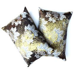 """<strong>Patch NYC</strong> Gold Floral Pillow Set, <a href=""""http://www.patchnyc.com/products/orange-silk-pillow-set-cpx1-o"""">$198</a>"""