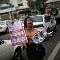 A Myanmar newspaper hawker sells newspapers at a traffic signal a day after landmark by-elections in Yangon, Myanmar, Monday, April 2, 2012. Myanmar's opposition icon Aung San Suu Kyi, 66, was elected to parliament Sunday in a historic victory buffeted by the jubilant cheers of supporters who hope her triumph will mark a major turning point in a nation still emerging from a ruthless era of military rule.