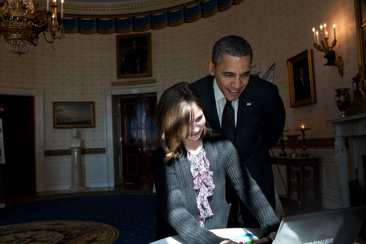 President Obama looks over shoulder at laptop (Credit: Pete Souza/The White House Flickr)
