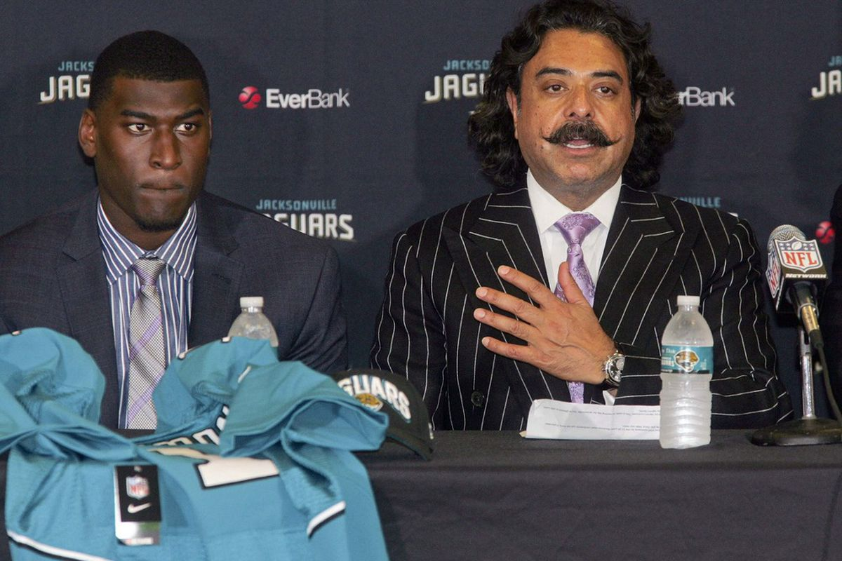 April 27, 2012; Jacksonville FL, USA;  Jacksonville Jaguars first round draft pick Justin Blackmon listens as owner Shad Khan speaks during a press conference at EverBank Field. Mandatory Credit: Phil Sears-US PRESSWIRE