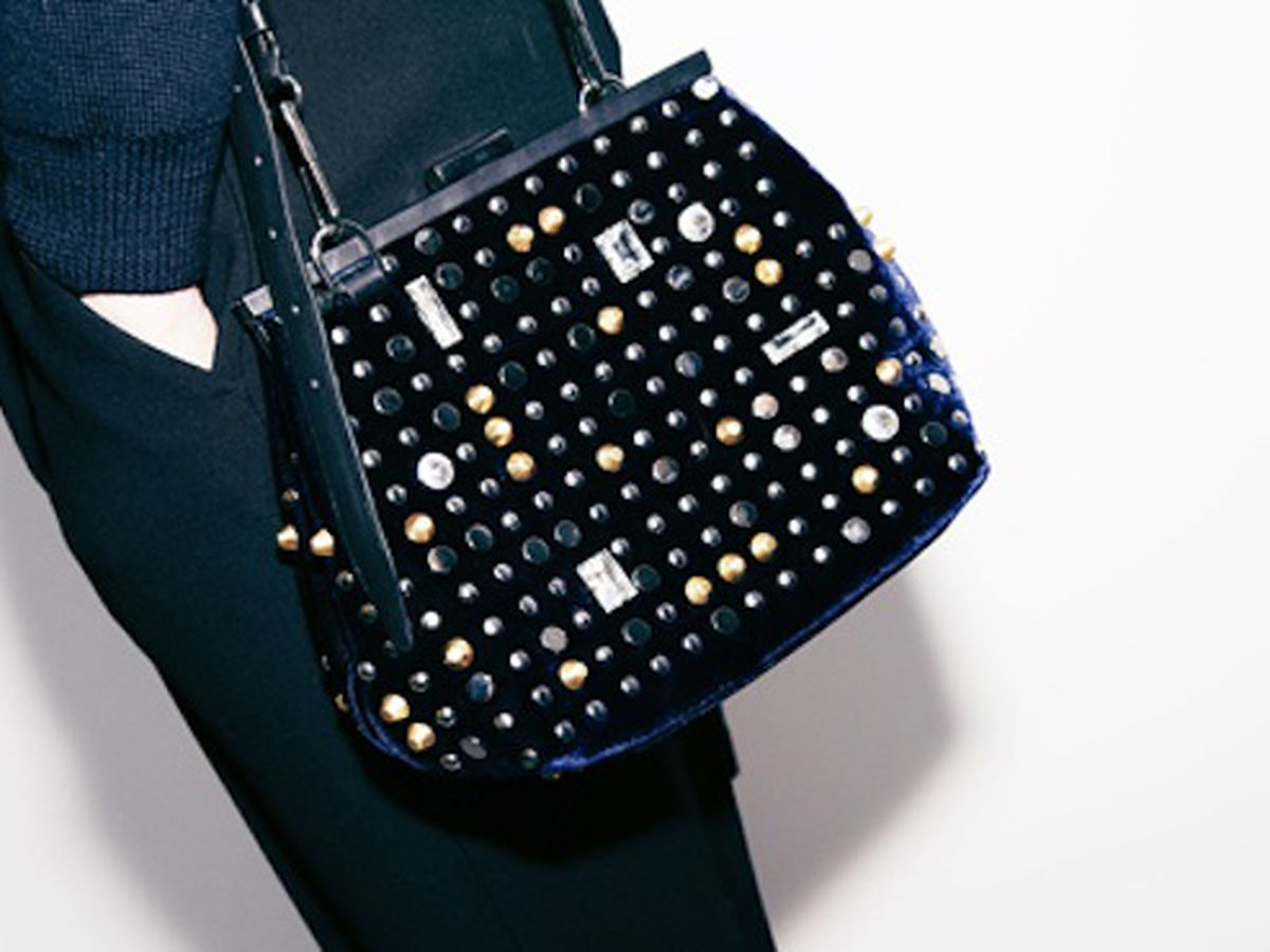 """The 3.1 Phillip Lim <a href=""""http://www.31philliplim.com/shop/category/womens_accessories/bags#frame-clutch-blk"""">Frame Clutch</a>"""