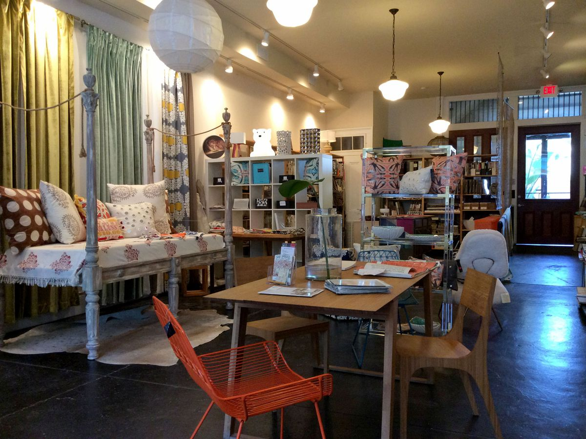 The interior of Spruce in New Orleans. There are various items of furniture and design on display in a room.