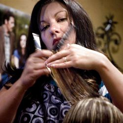Jessica Bronson is a self-employed hair stylist who works out of her home in West Valley on Tuesday, September 27, 2011.
