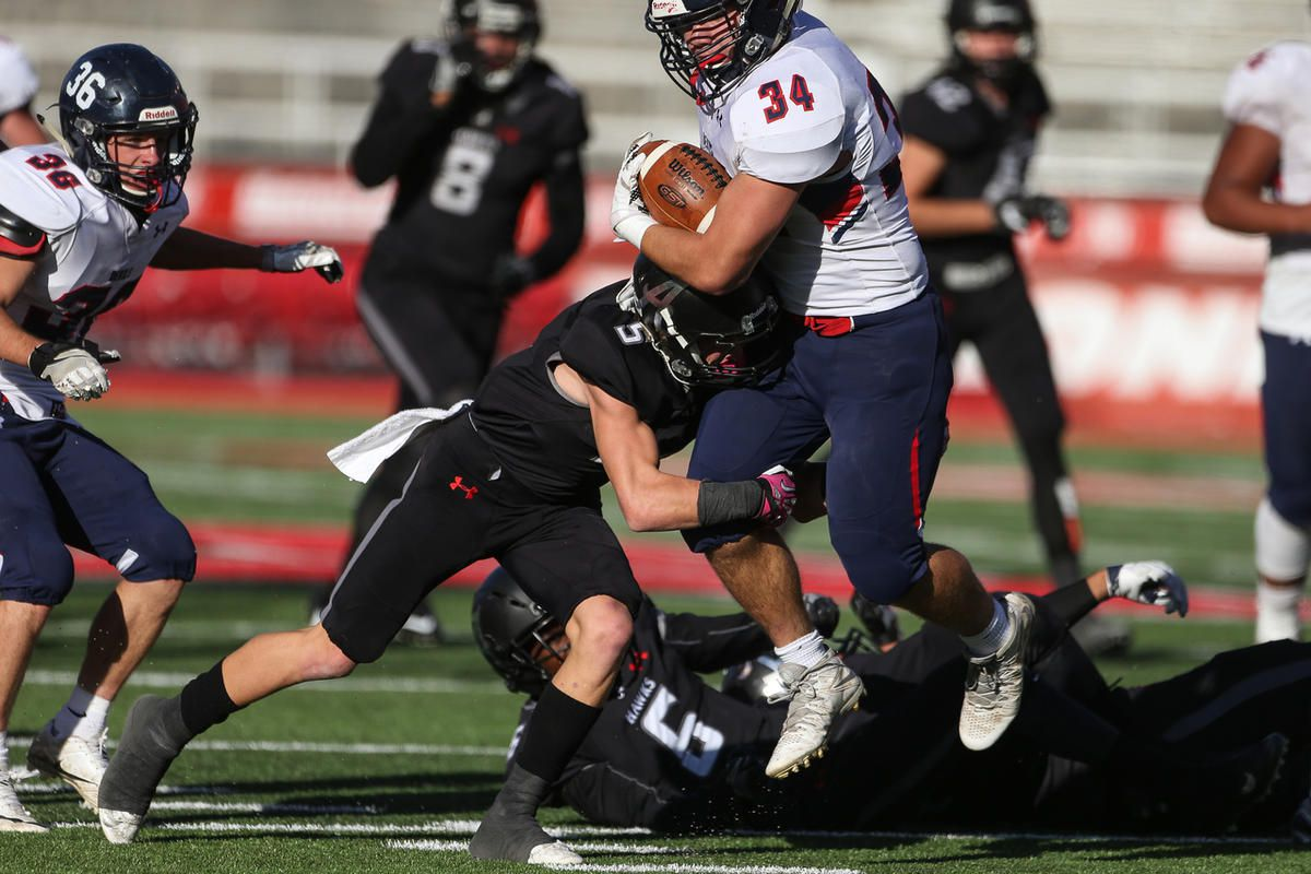 FILE: Alta's London Rockwood takes down Springville's Payton Kelepolo after a run in a UHSAA 4A semifinals game at Rice-Eccles Stadium in Salt Lake City on Friday, Nov. 11, 2016.