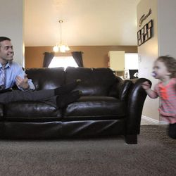 Katelyn, 1, runs to her dad, Jeff Griffin, in their home in West Jordan on Thursday, Feb. 27, 2014.