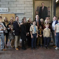 President Henry B. Eyring, first counselor in the First Presidency of the Church of Jesus Christ of Latter-day Saints, and the Sorenson family pose for a photo after the dedication of the Thomas S. Monson Lodge at the Hinckley Scout Ranch in the Uinta Mountains on Wednesday, Oct. 5, 2016.