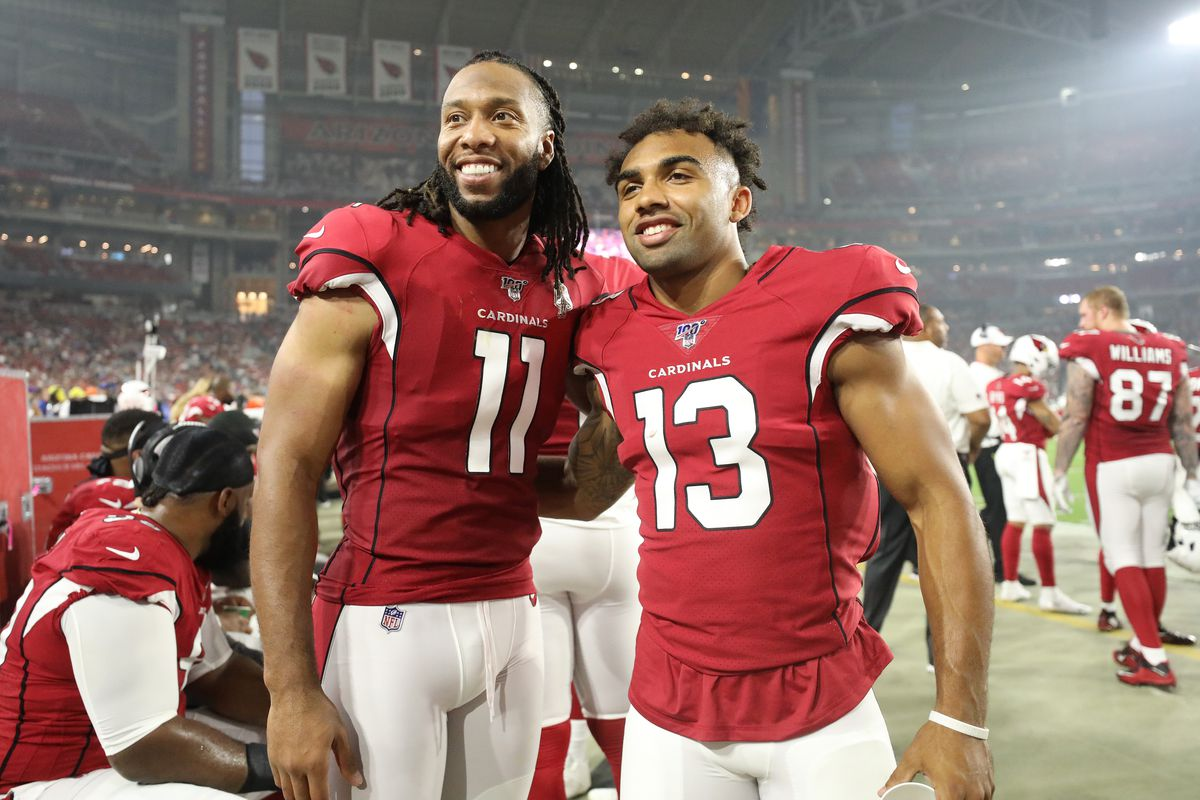 Larry Fitzgerald and Christian Kirk of the Arizona Cardinals pose for a picture during a preseason game against the Los Angeles Chargers at State Farm Stadium on August 08, 2019 in Glendale, Arizona.