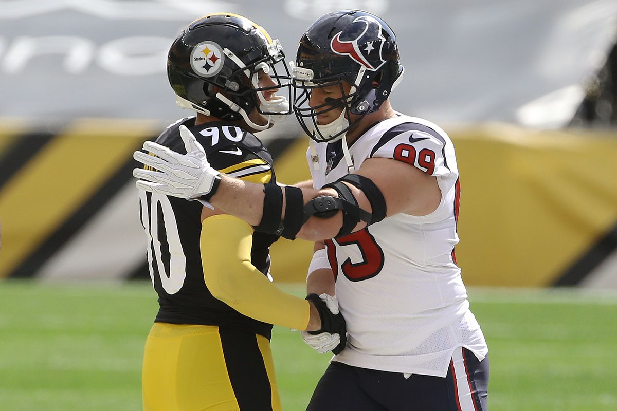 Brothers Pittsburgh Steelers outside linebacker T.J. Watt (90) and Houston Texans defensive end J.J. Watt (99) embrace after the coin toss at Heinz Field.