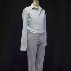 Matching the pale blue hue of Juliet's costume, Romeo wears a simple shirt and fitted grey pants.