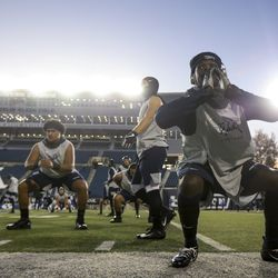 The Utah State Aggies warm up before the start of an NCAA football game between the Brigham Young Cougars and the Utah State Aggies at Maverik Stadium in Logan on Saturday, Nov. 2, 2019.
