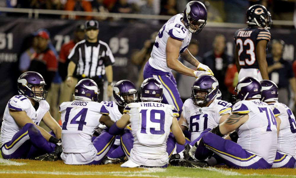 Minnesota Vikings tight end Kyle Rudolph (82) celebrates a touchdown with his teammates during the second half of an NFL football game against the Chicago Bears, Monday, Oct. 9, 2017, in Chicago. (AP Photo/Darron Cummings) ORG XMIT: CXB1