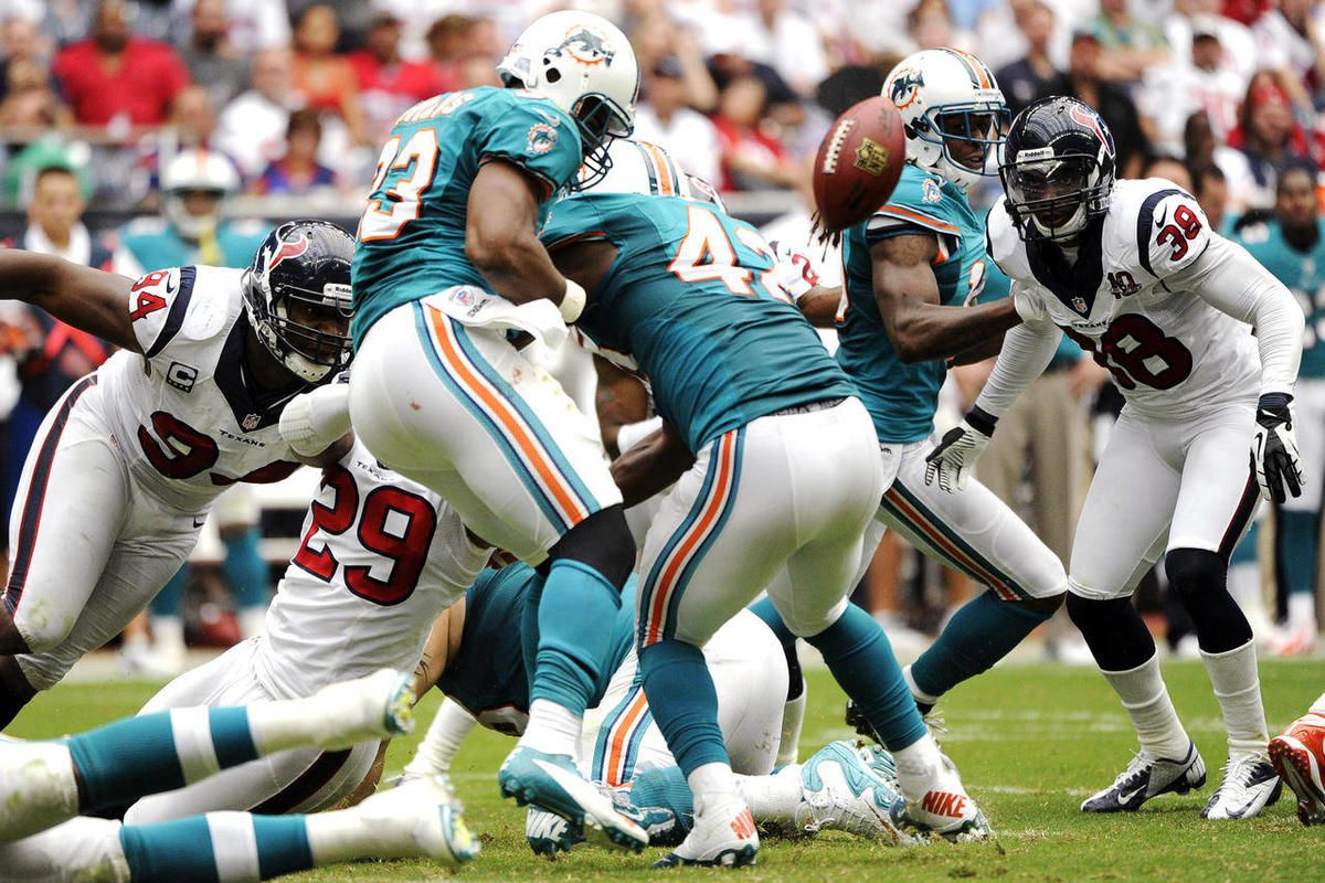 Miami Dolphins running back Daniel Thomas (33) fumbles the ball as he is hit by Houston Texans strong safety Glover Quin (29) in the second quarter of an NFL football game, Sunday, Sept. 9, 2012, in Houston. The Texans recovered the fumble.