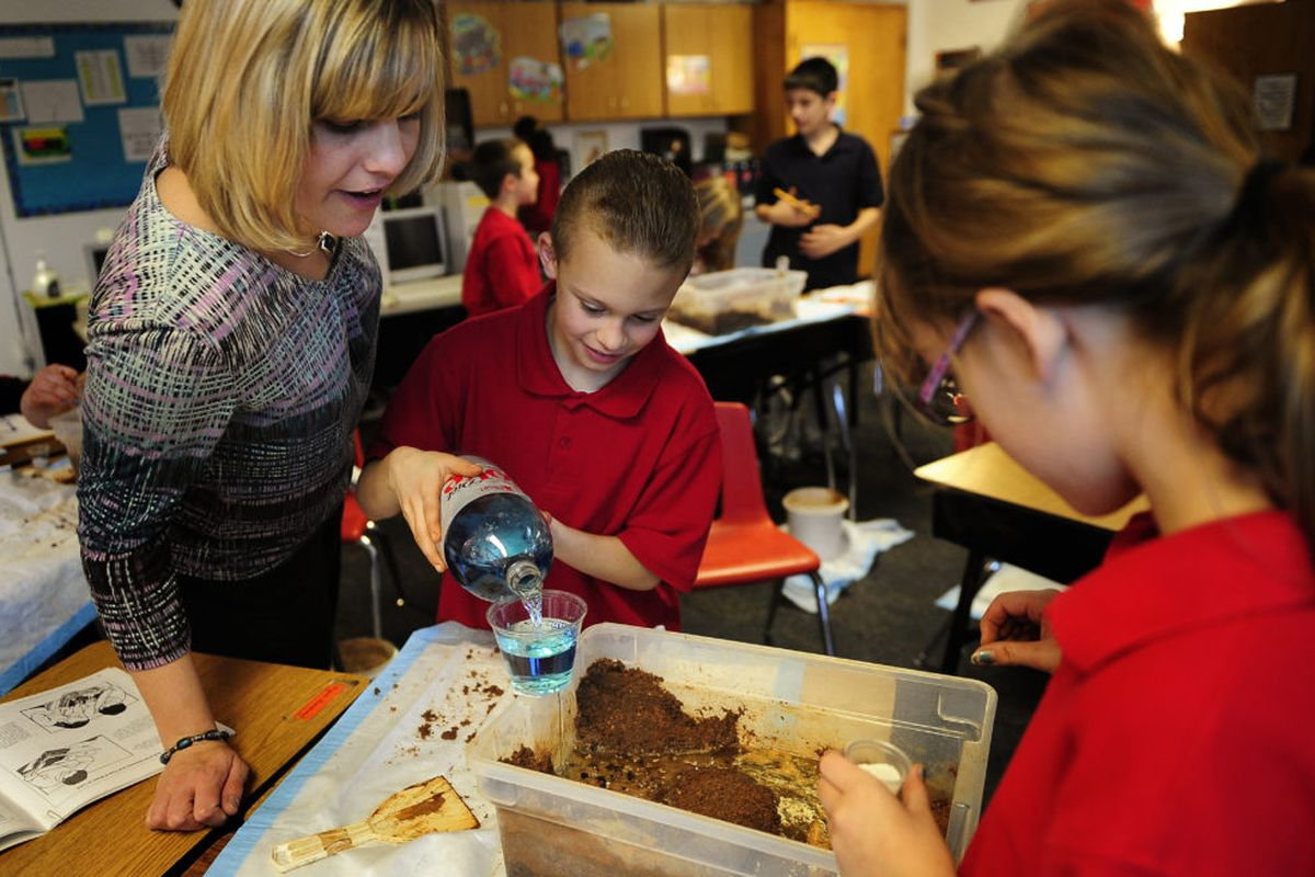 Jana Thomas watches the progress of her fourth-grade students as they learn about the effects water and land have on each other at Chamberlin Academy, an elementary school in the Harrison district. (Photo By Joe Amon/The Denver Post via Getty Images)
