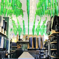 These bottles suspended from the ceiling are hand-blown and come from the brewery of a former Lululemon employee in Colorado, a store rep confirms.