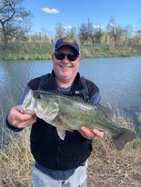 Andy Hansen with a city park largemouth bass. Provided