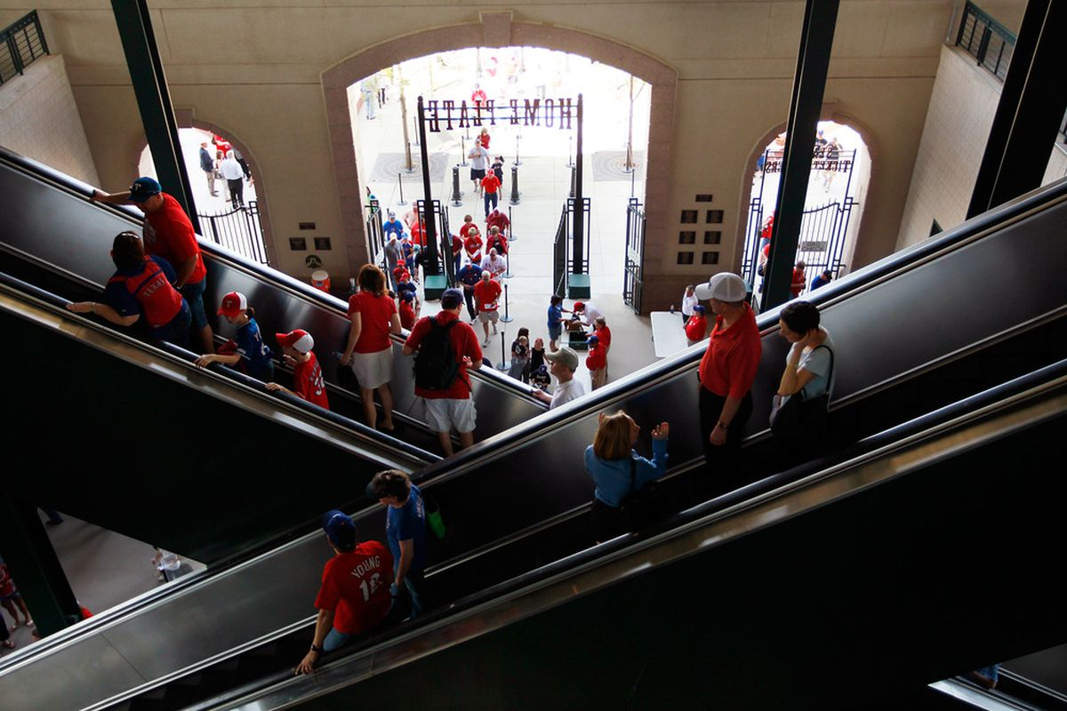 ARLINGTON, TX - APRIL 01:  Baseball fans arrive at Rangers Ballpark in Arlington for Opening Day as the Boston Red Sox take on the Texas Rangers on April 1, 2011 in Arlington, Texas.  (Photo by Tom Pennington/Getty Images)