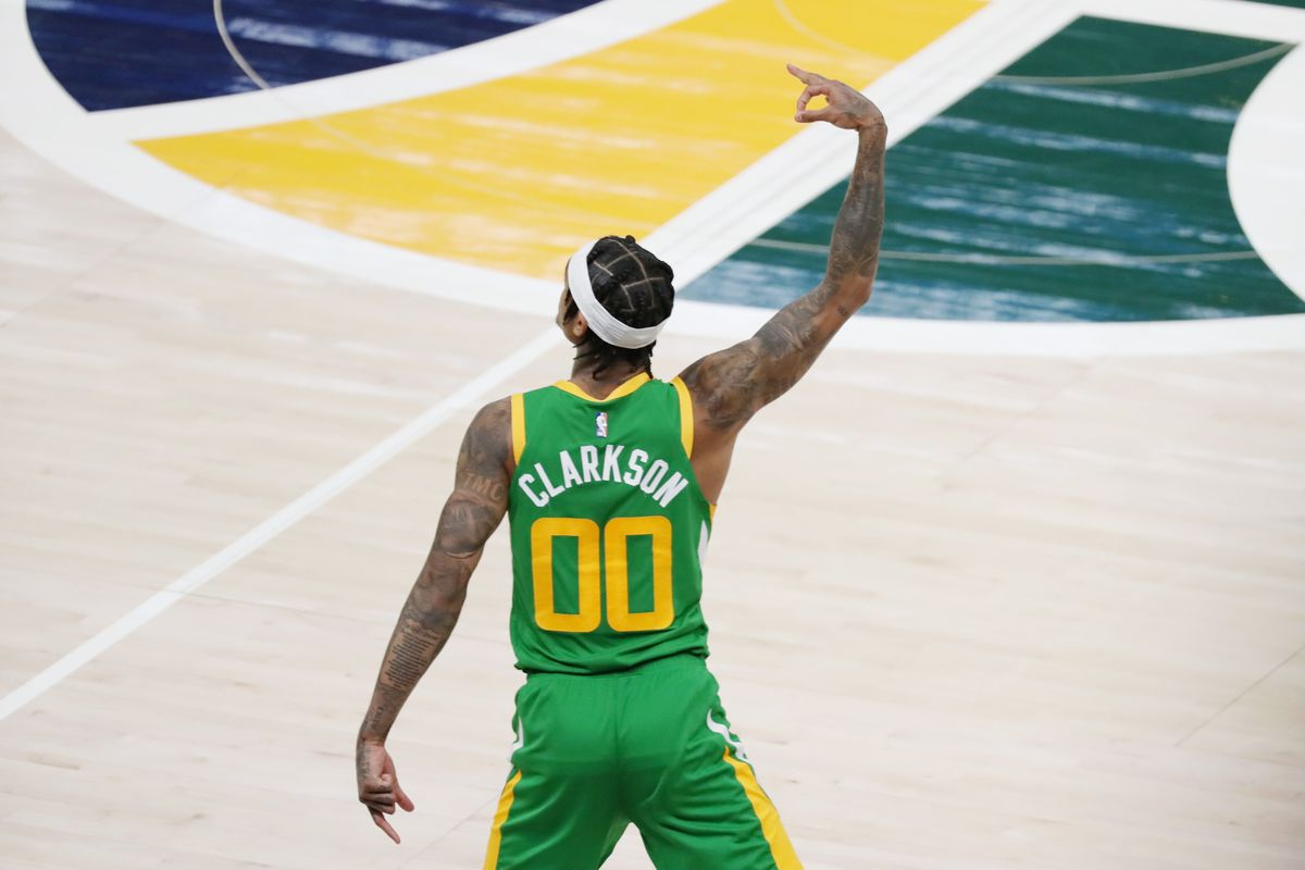 Utah Jazz guard Jordan Clarkson reacts to making a three point shot against the Denver Nuggets in the fourth quarter at Vivint Arena.