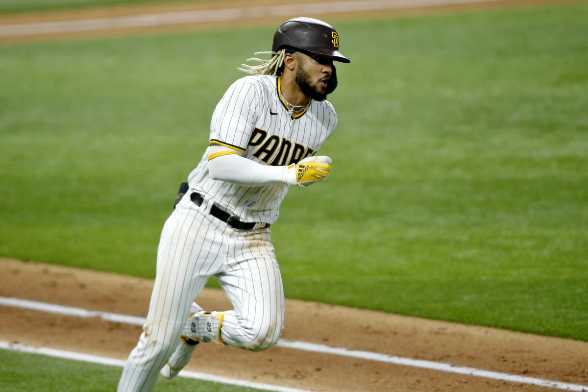 San Diego Padres shortstop Fernando Tatis Jr. rounds first base on his double against the Los Angeles Dodgers during the sixth inning during game three of the 2020 NLDS at Globe Life Field.