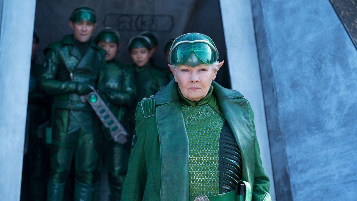 judi dench with elf ears, wearing shiny green armor