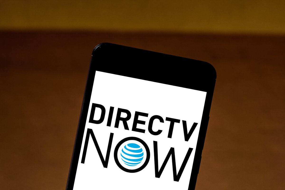In this photo illustration the DirecTV Now logo is seen...
