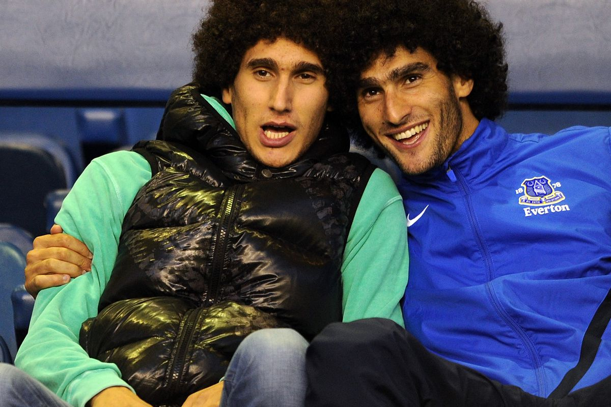 Competition winner Linda's favourite player Marouane Fellaini sharing a joke with his brother.