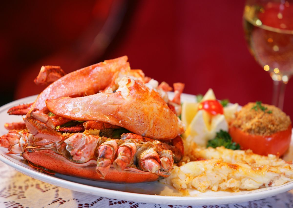 A plate with lobster and a red background