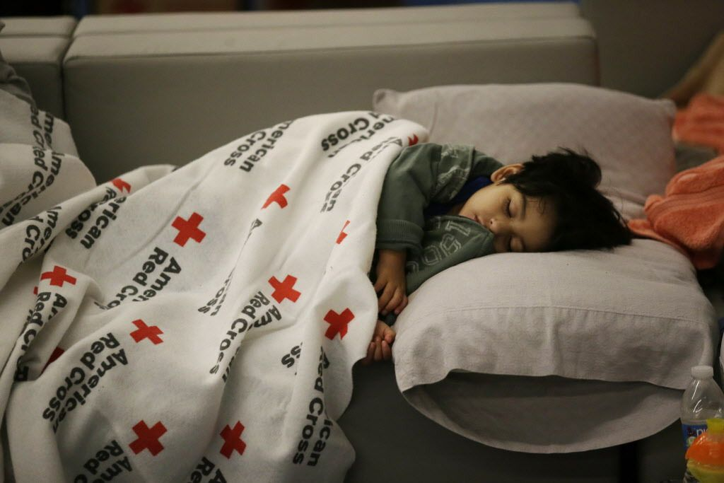 Malachia Medrano, 2, sleeps at the George R. Brown Convention Center, which has been set up as a shelter for evacuees escaping the floodwaters on Tuesday, Aug. 29, 2017. LM Otero/AP