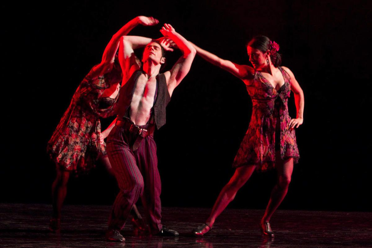 """In this undated image released by Paul Taylor Dance Company, dancers perform a passionate tango-inflected dance with furious turns in """"Piazzola Caldera,"""" at the David H. Koch Theater at Lincoln Center in New York."""