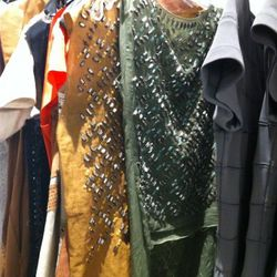 The beaded tunics are pretty, but look carefully as some are missing beads.