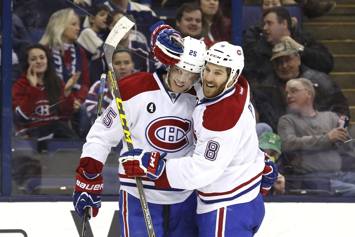 Feb 26, 2015; Columbus, OH, USA; Montreal Canadiens left wing Jacob De La Rose (25) celebrates his first goal of the season with right wing Brandon Prust (8) in the third period at Nationwide Arena. The Canadiens 5-2. Mandatory Credit: Aaron Doster-U
