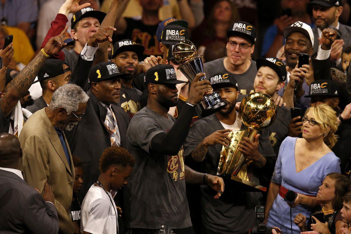 Cleveland Cavaliers' LeBron James (23) holds the MVP trophy after the Cavaliers beat the Golden State Warriors in Game 7 93-89 to win the NBA Finals at Oracle Arena in Oakland, Calif., on Sunday, June 19, 2016. (Nhat V. Meyer/Bay Area News Group)