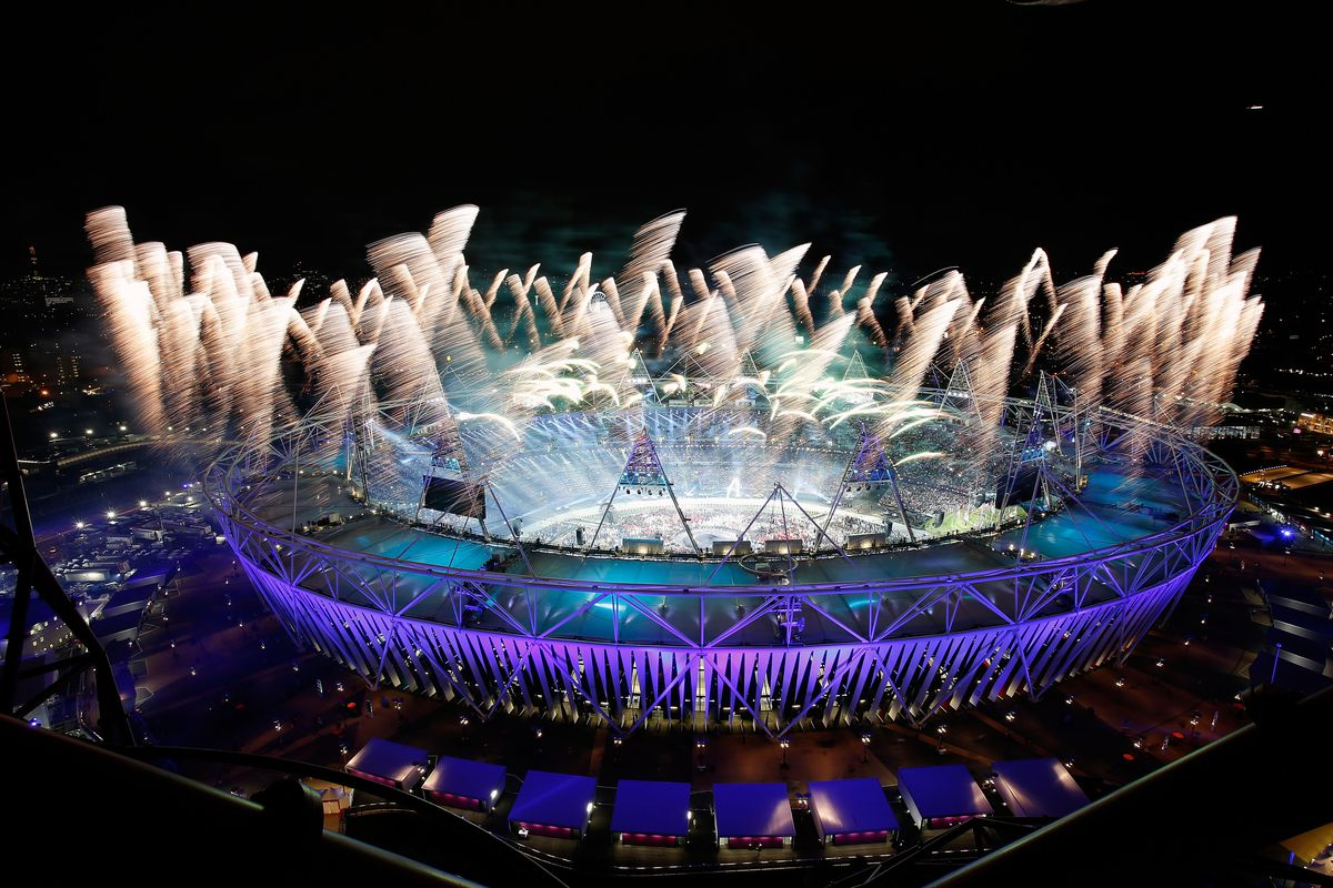 LONDON, ENGLAND - JULY 27:  Fireworks ignite over the Olympic Stadium during the Opening Ceremony for the 2012 Olympic Games on July 27, 2012 at Olympic Park in London, England.  (Photo by Jamie Squire/Getty Images)  *** BESTPIX ***