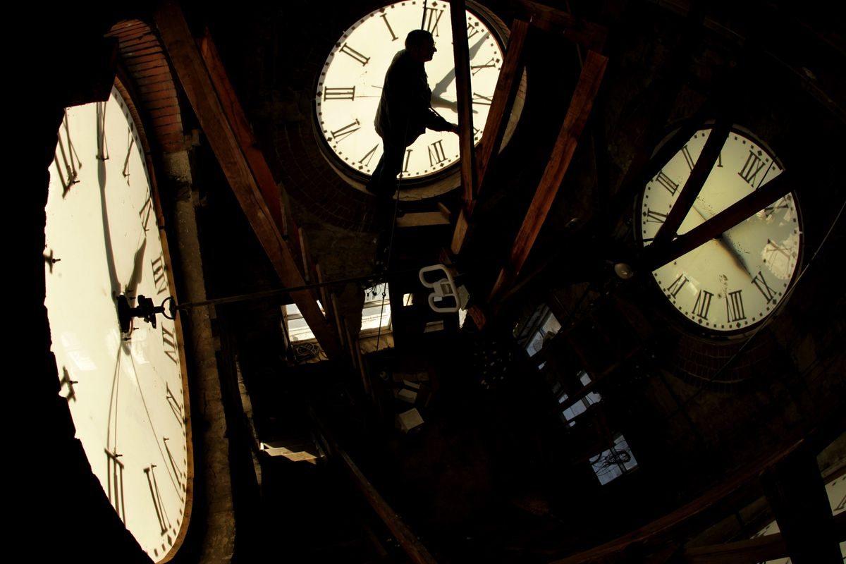 Custodian Ray Keen checks the time on a clock face after changing the time on the 97-year-old clock atop the Clay County Courthouse, Saturday, Nov. 6, 2010, in Clay Center, Kansas. Keen was setting time back an hour in advance of the end of daylight savin