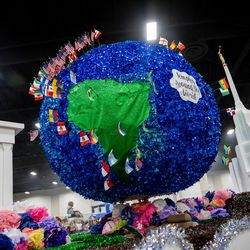 A float by the South Jordan Midas Creek Stake depicts temple locations around the world during the Days of '47 Float Preview Party at the Mountain America Expo Center in Sandy on Tuesday, July 20, 2021.