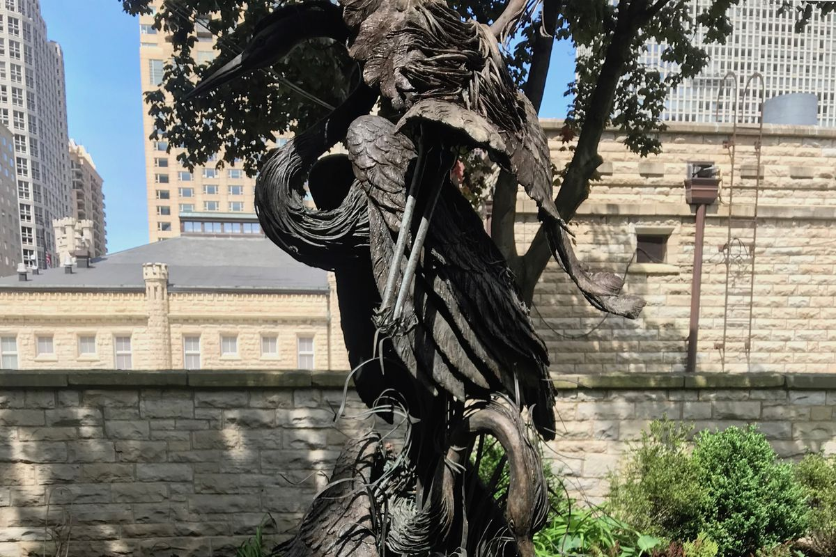 Ritz-Carlton's heron statue now nestled outside nearby firehouse No. 98