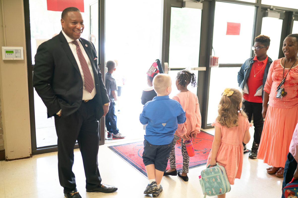 Superintendent Joris Ray with students in Memphis.