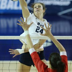 BYU's Kennedy Redding hits over American's Cheyenne Orsi during the NCAA tournament in Provo on Friday, Dec. 1, 2017.
