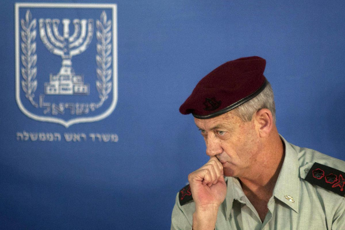 FILE - In this Feb. 14, 2011 file photo, Israeli Chief of Staff Lt. Gen. Benny Gantz looks on during a change of the epaulets ceremony in the Prime Minister's office in Jerusalem. Israel's military chief has hinted that other countries could also strike I