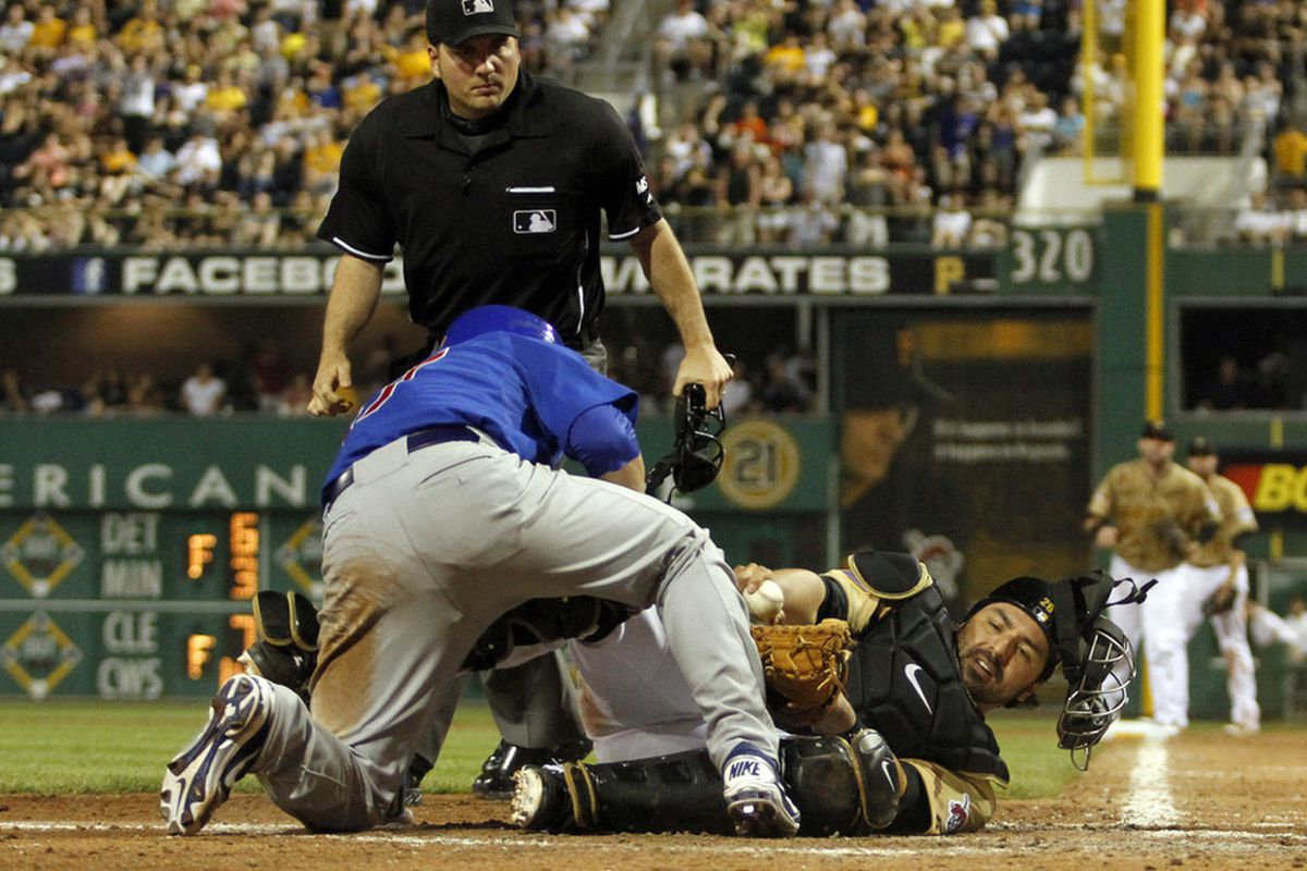 Blake Lalli of the Chicago Cubs is out as he collides with Rod Barajas of the Pittsburgh Pirates at PNC Park in Pittsburgh, Pennsylvania. The Pirates defeated the Cubs 3-2.  (Photo by Justin K. Aller/Getty Images)