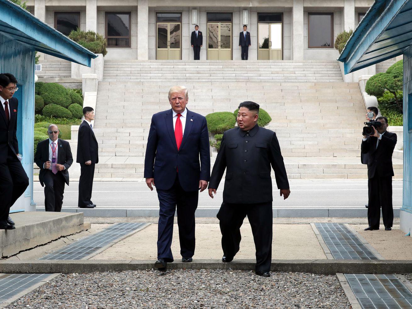 Donald Trump and Kim Jong Un cross the DMZ in Panmunjom, South Korea.