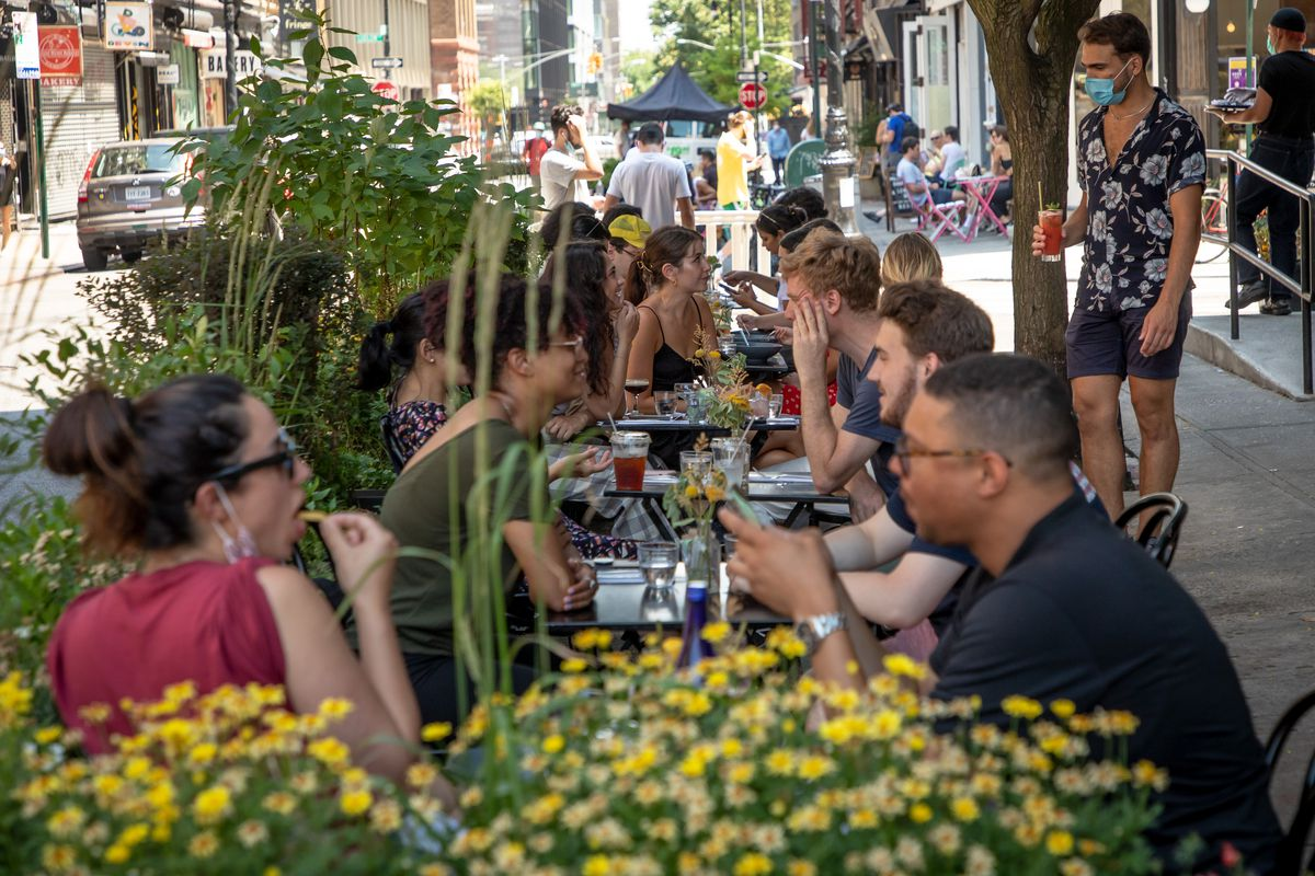 Customers participate in outdoor dining at Dudley's