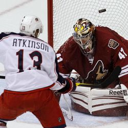 Phoenix Coyotes' Mike Smith (41) makes a save on a shot by Columbus Blue Jackets' Cam Atkinson (13) during the second period in an NHL hockey game Tuesday, April 3, 2012, in Glendale, Ariz.