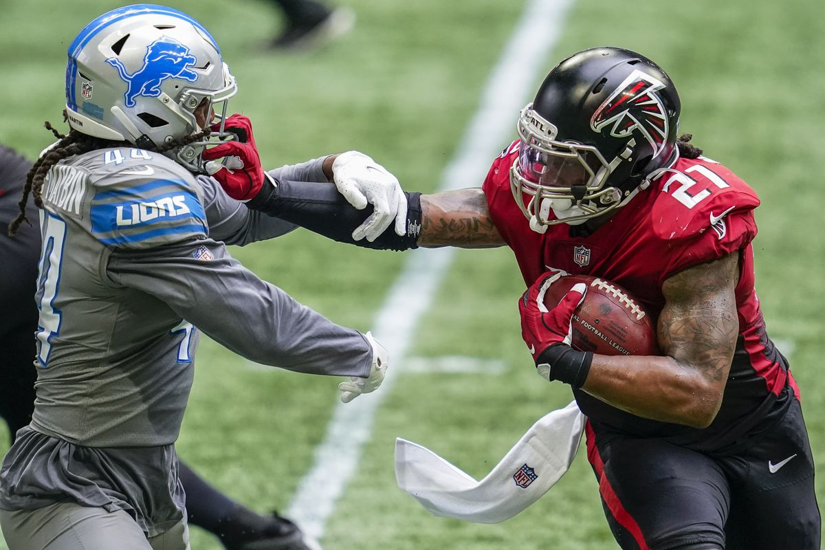 Falcons running back Todd Gurley II (21) attempts to prevent a tackle by Detroit Lions linebacker Jalen Reeves-Maybin (44) during the second half at Mercedes-Benz Stadium.