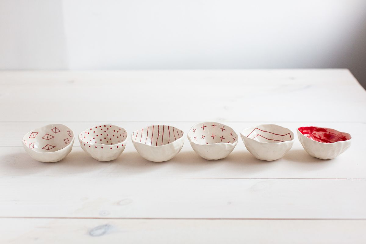 A set of six small pinch bowls in different patterns.